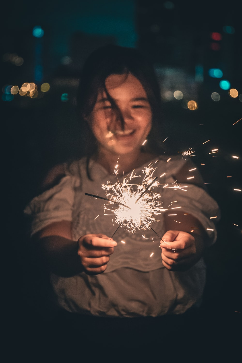 girl playing sparklers