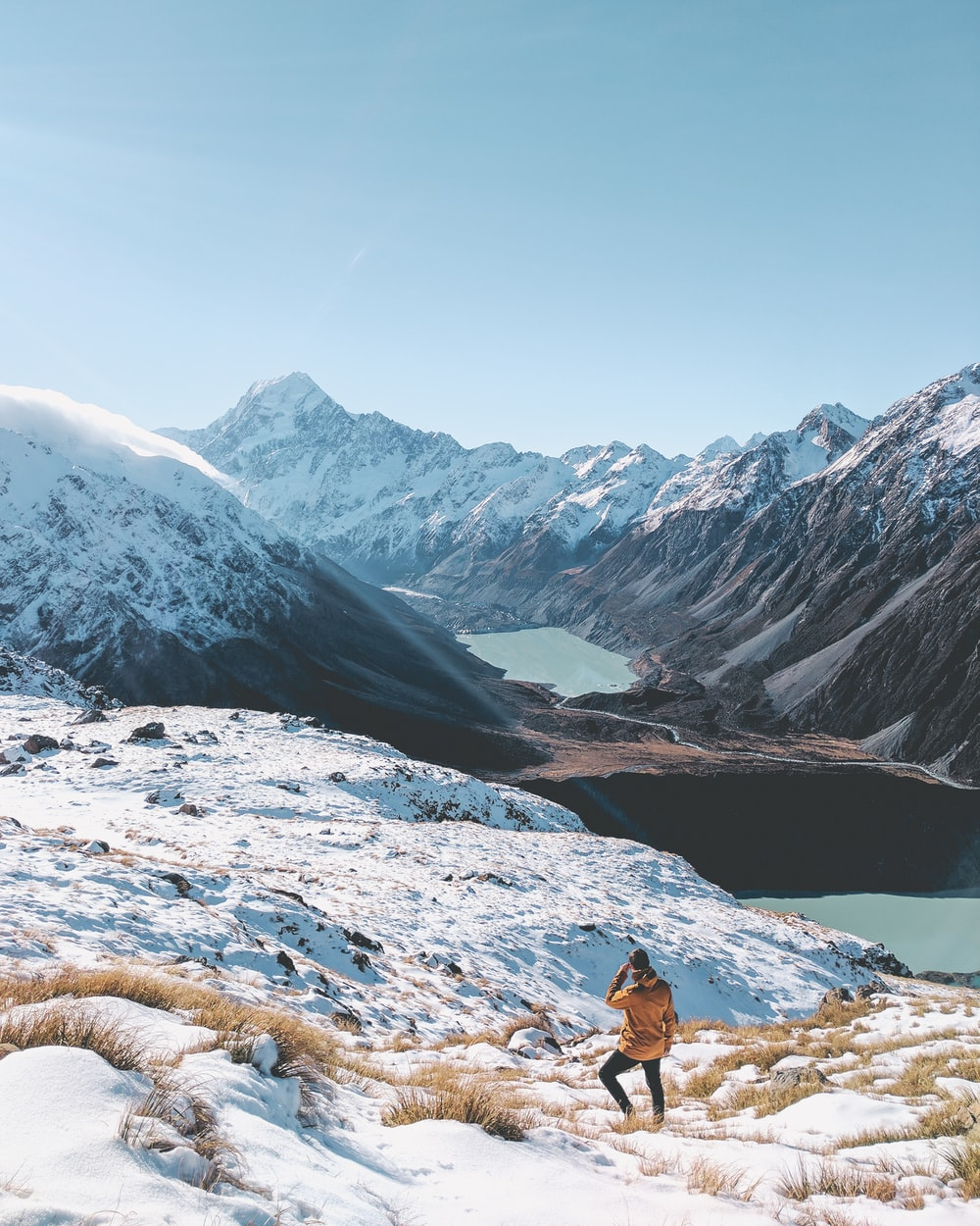 person standing on snow covered mountain