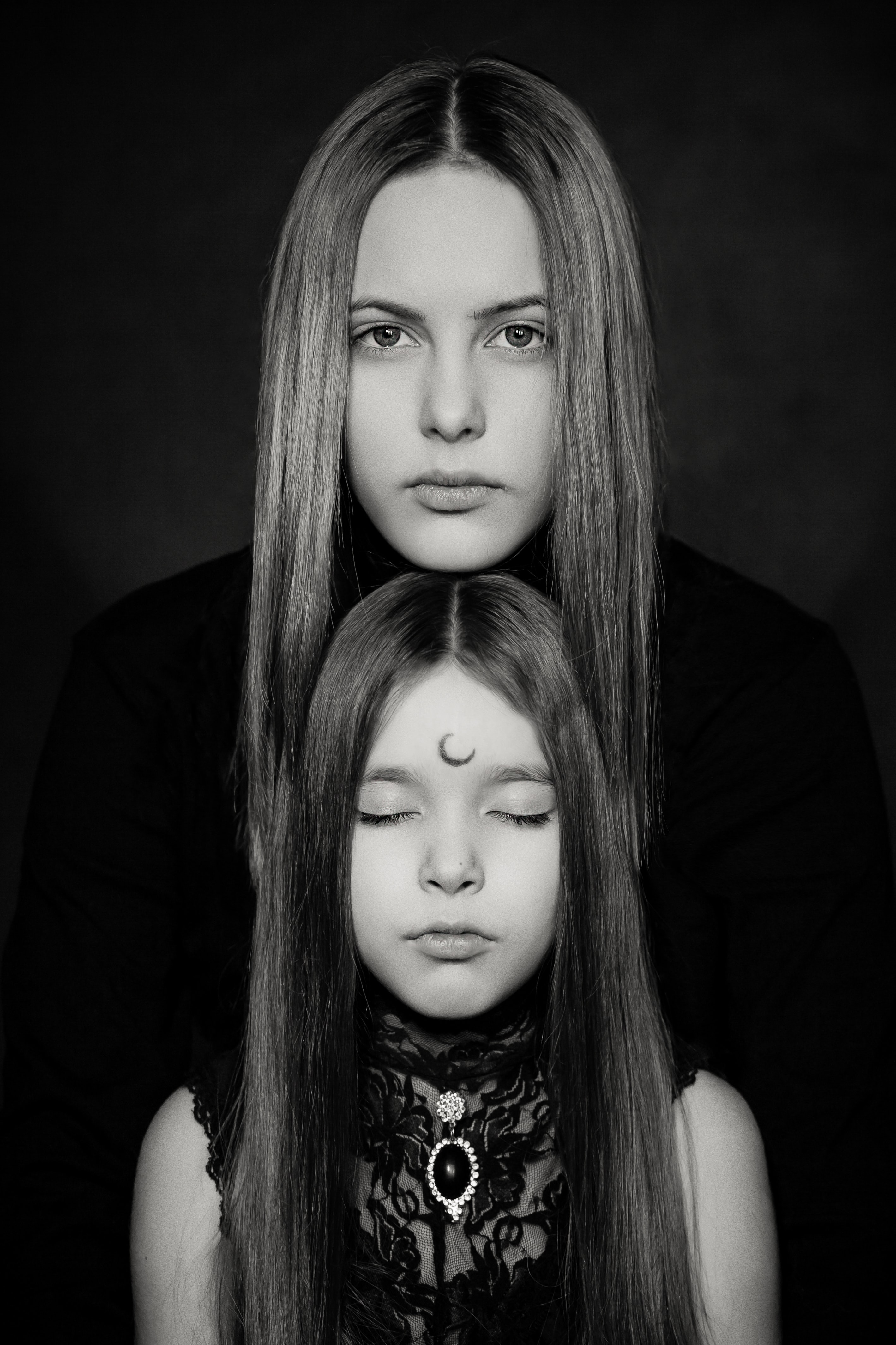 grayscale photography of two women