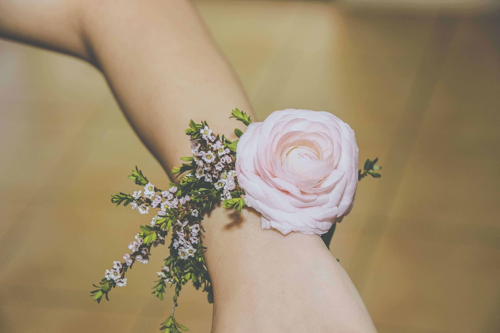 person wearing pink corsage