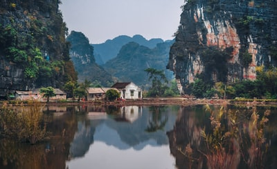 white house between two cliffs vietnam teams background