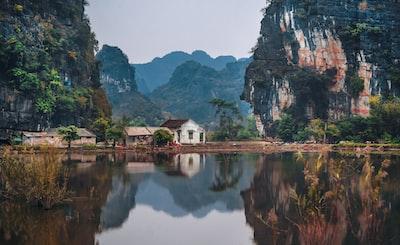 white house between two cliffs vietnam zoom background