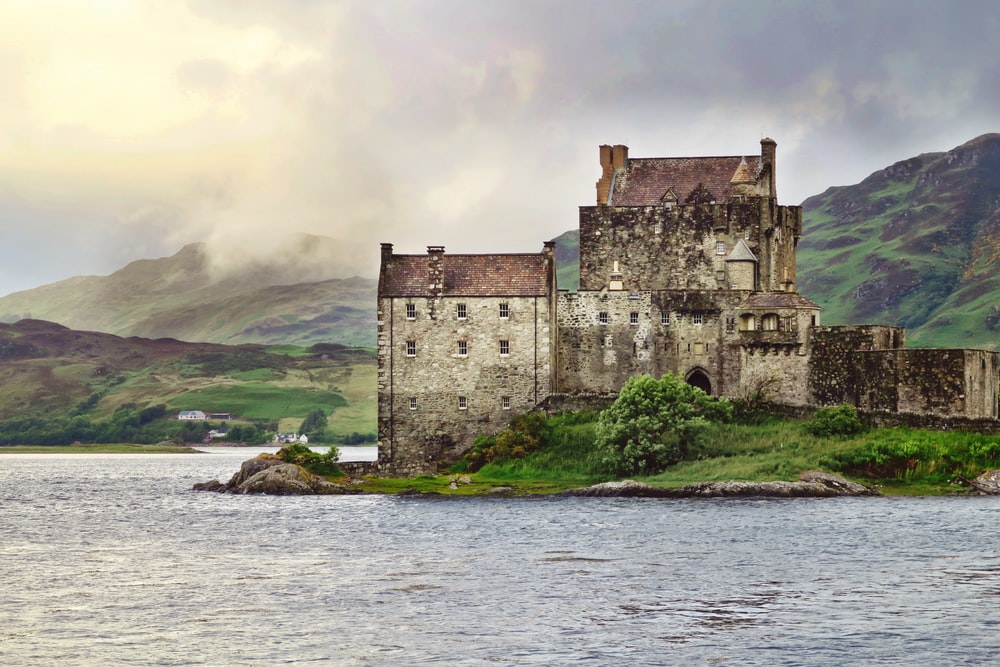 landscape photography of old building near body of water