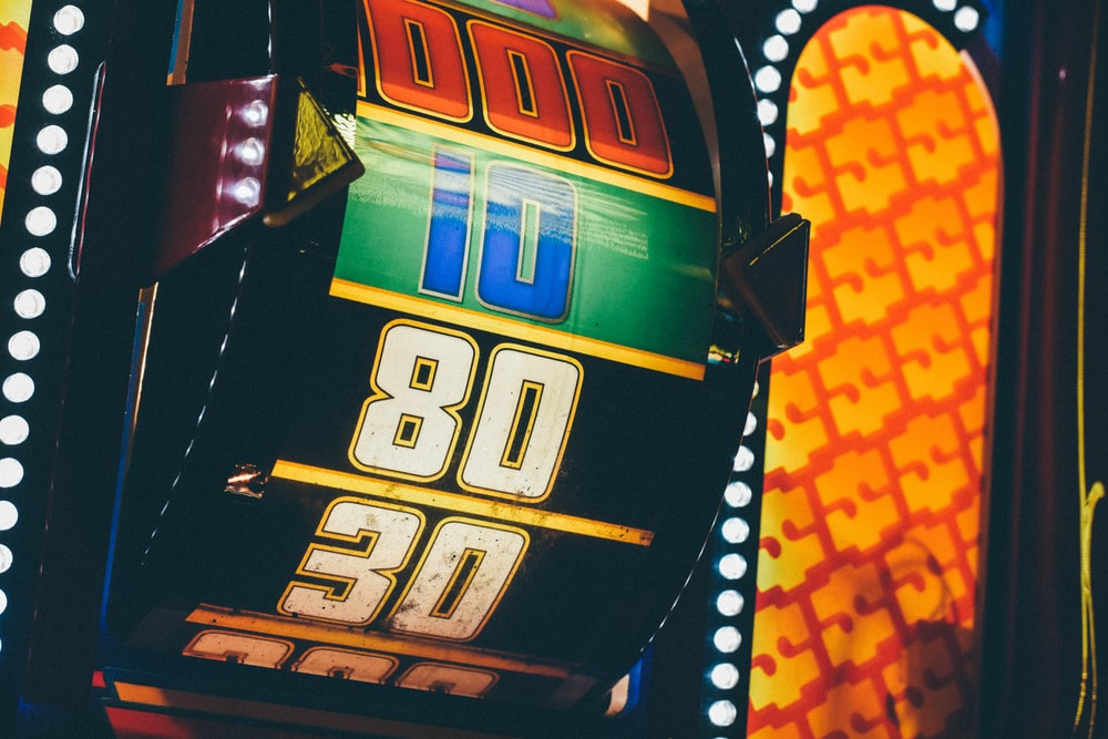 lighted slot machine at nighttime