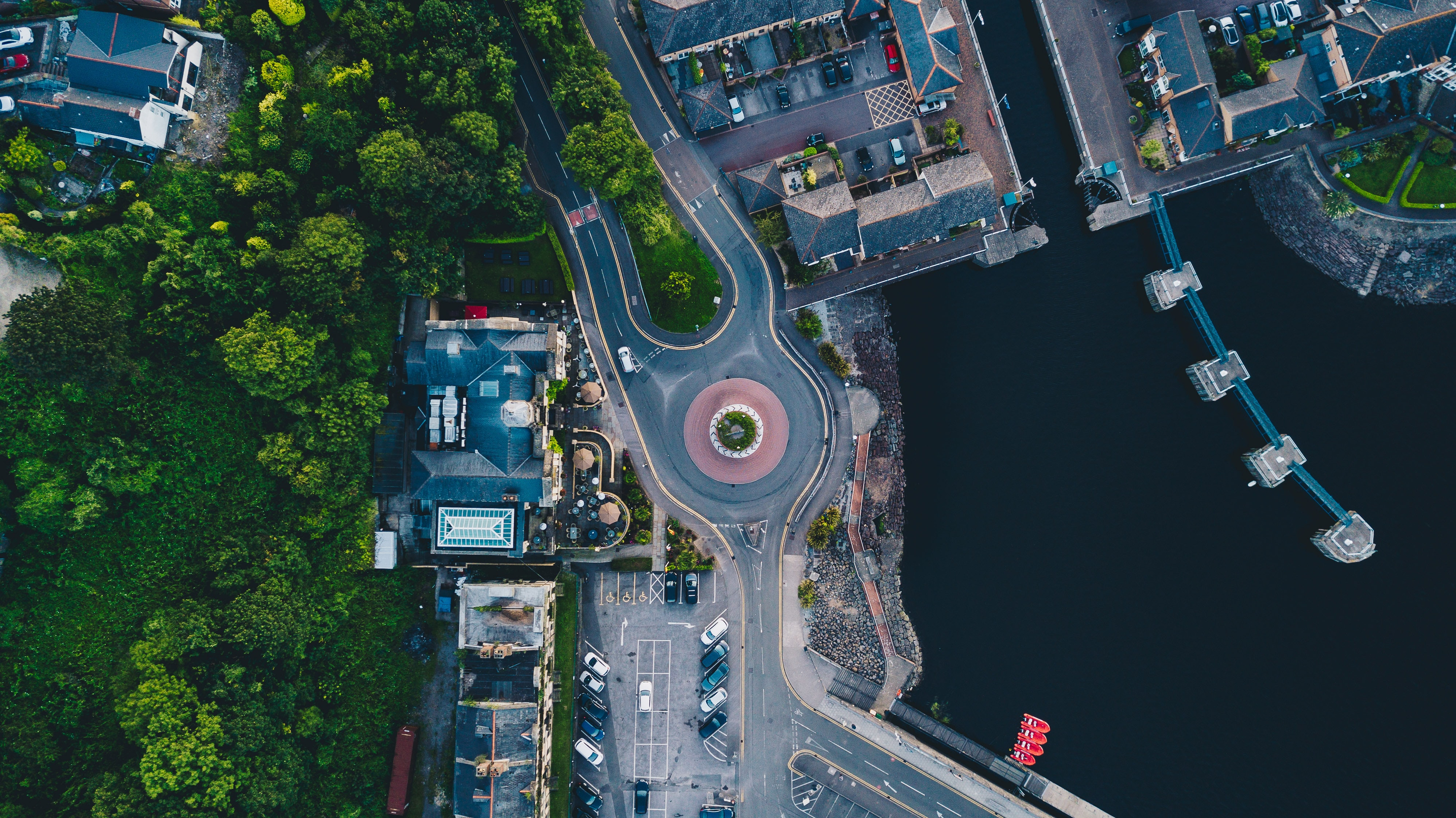 aerial photography of buildings near body of water