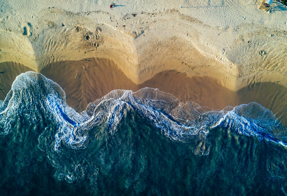 birds eye view photography of white sand seashore