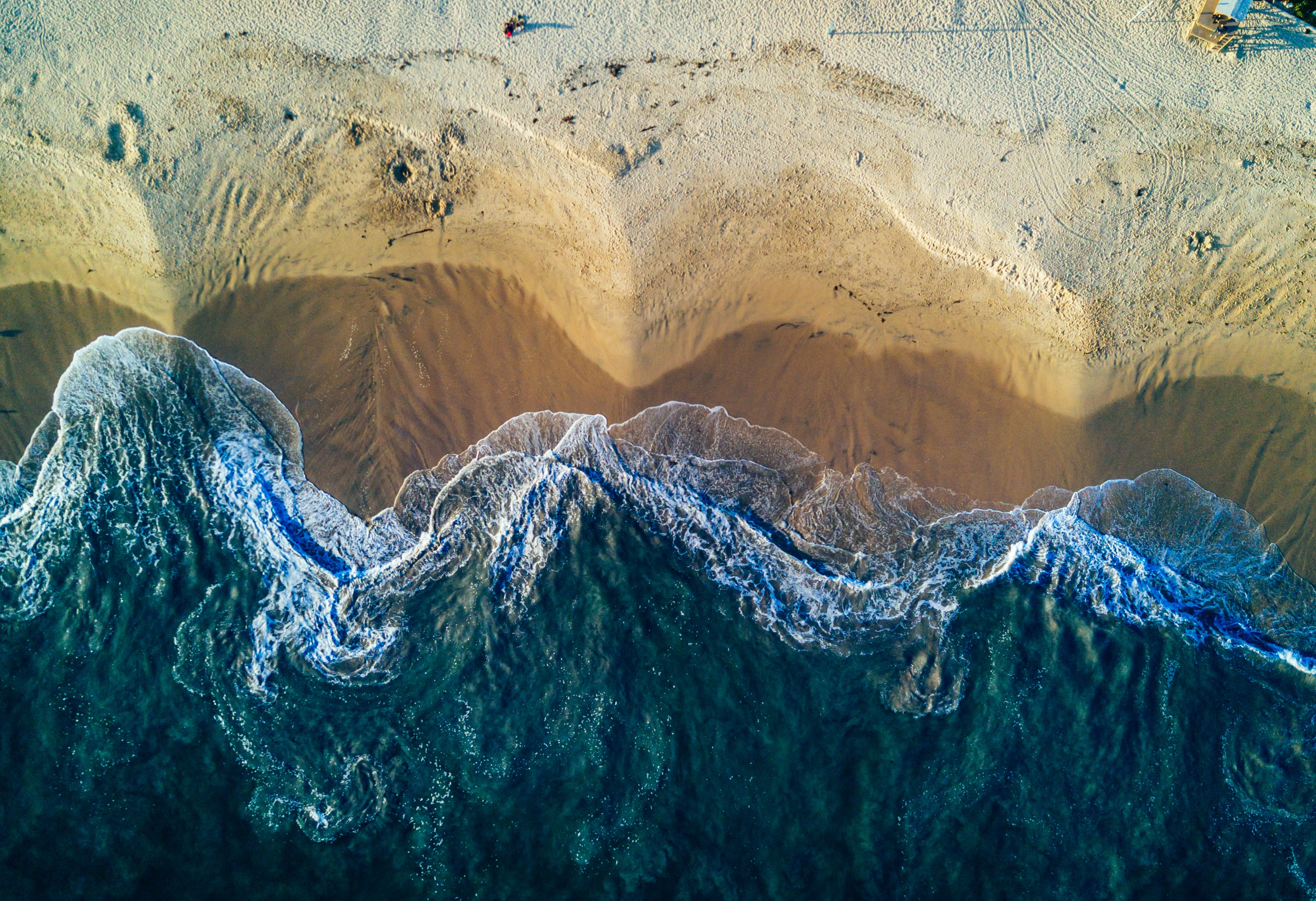 birds eye view photography of white sand seashore
