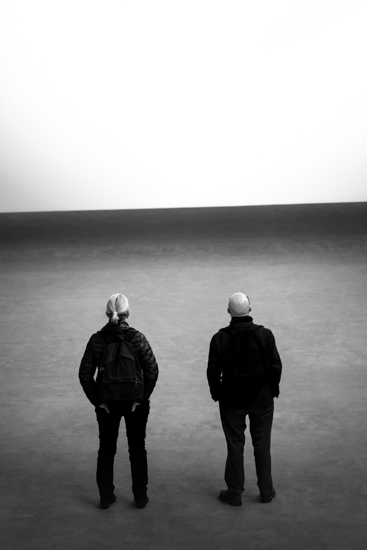 man and woman facing backward photography