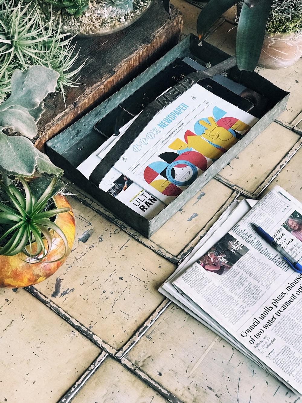 white newspaper article on beige floor tiles