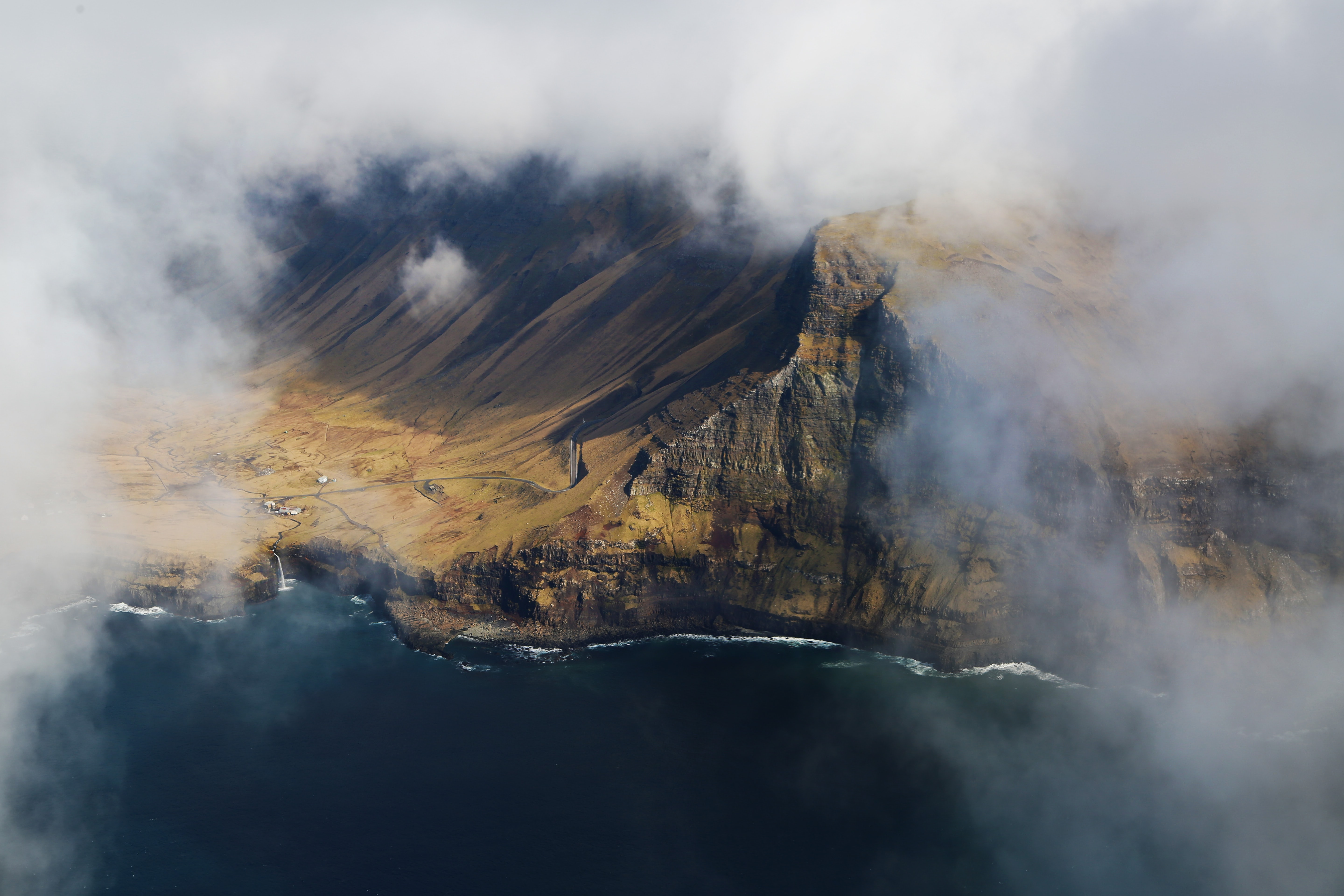 bird's eye view photography of cliff and mountain