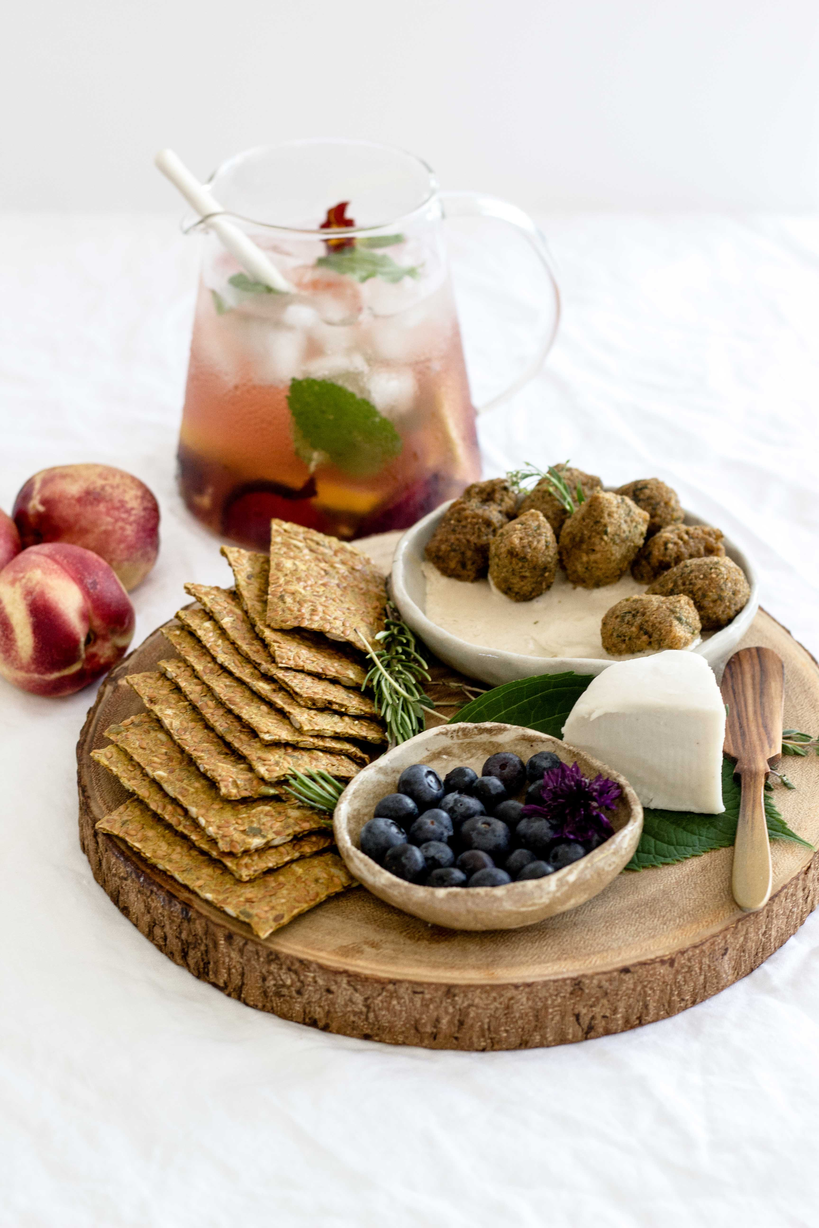 assorted-cook foods on round brown wooden tray