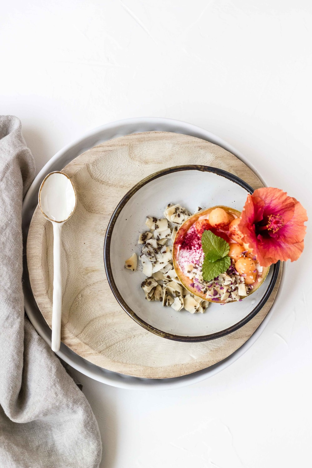white spoon on brown wooden plate
