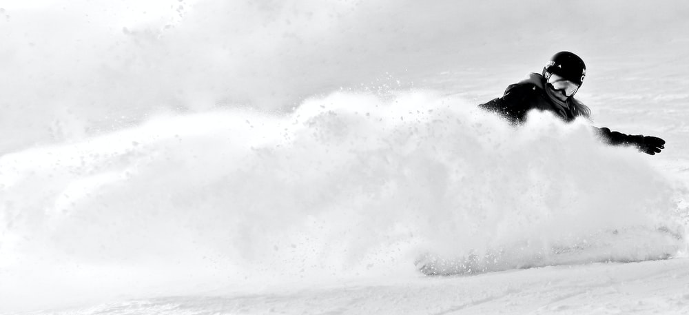 grayscale photography of person skiing