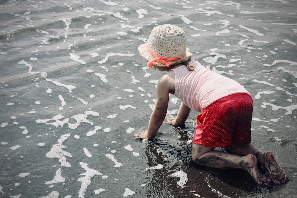 girl crawling at the seashore