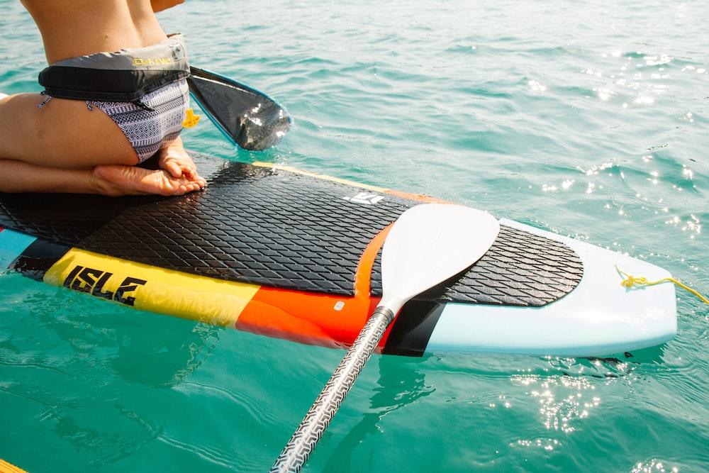 man riding paddle board
