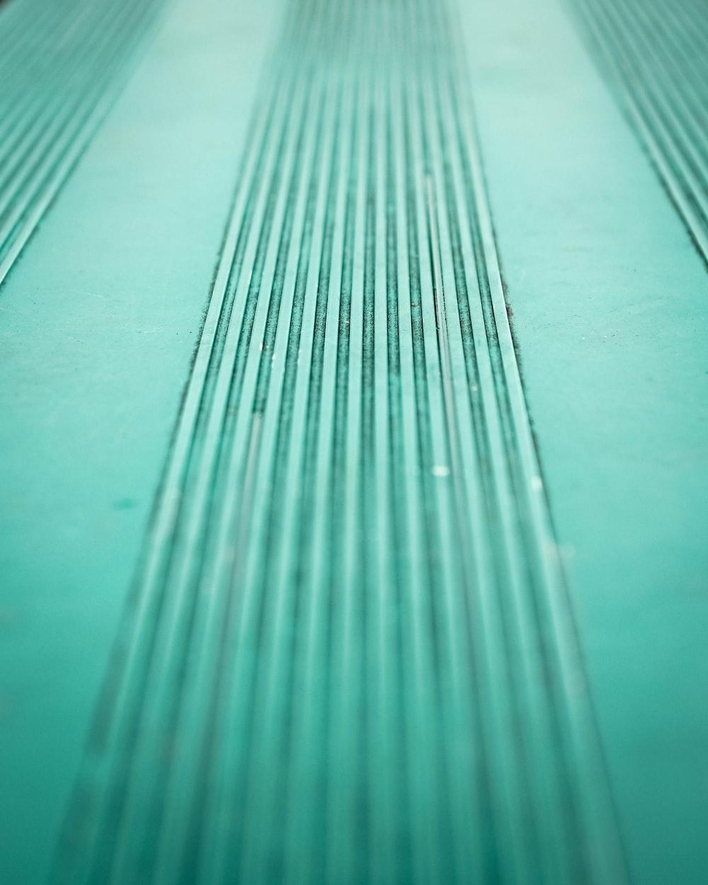 A bluish green line texture pattern.