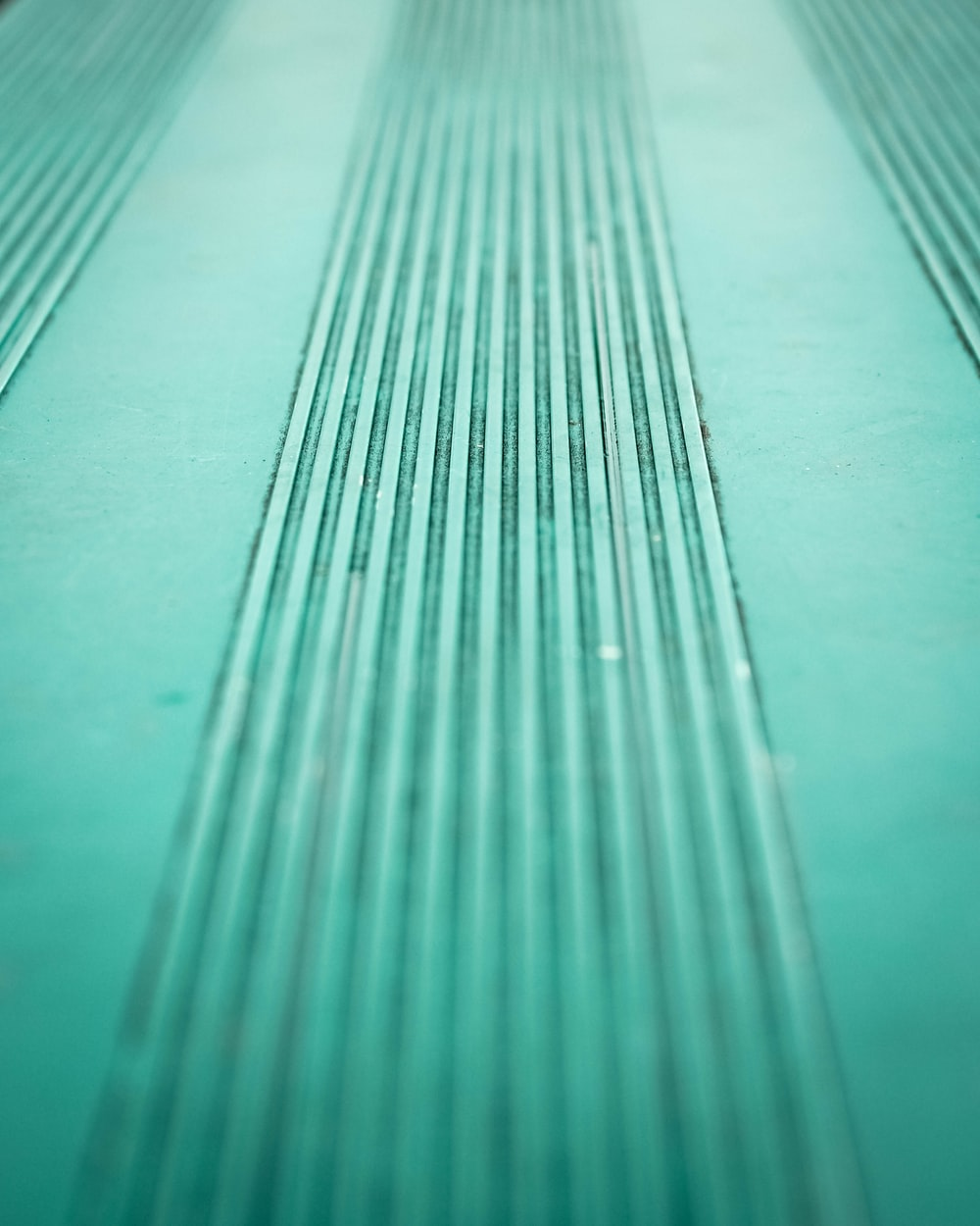 Vertical wallpaper pictures download free images on unsplash a bluish green line texture pattern voltagebd Choice Image