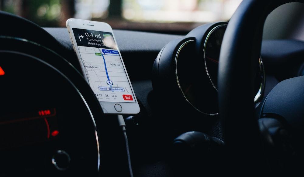 iPhone on vehicle phone holder