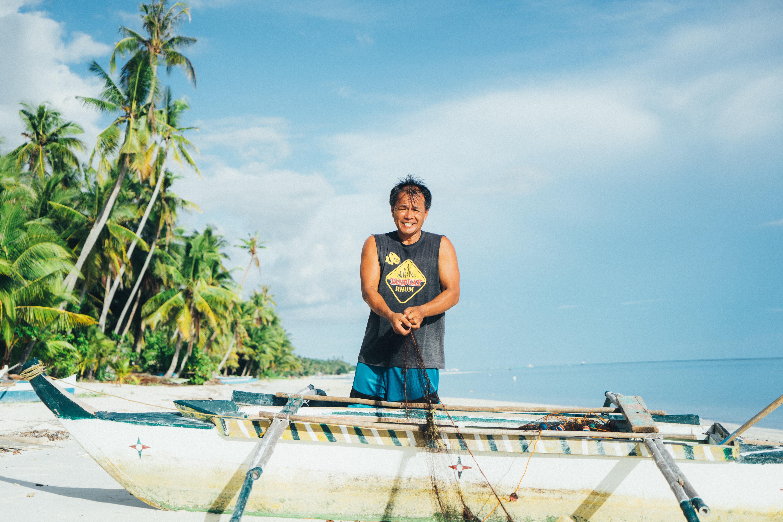 man holding rope on seashore during daytime