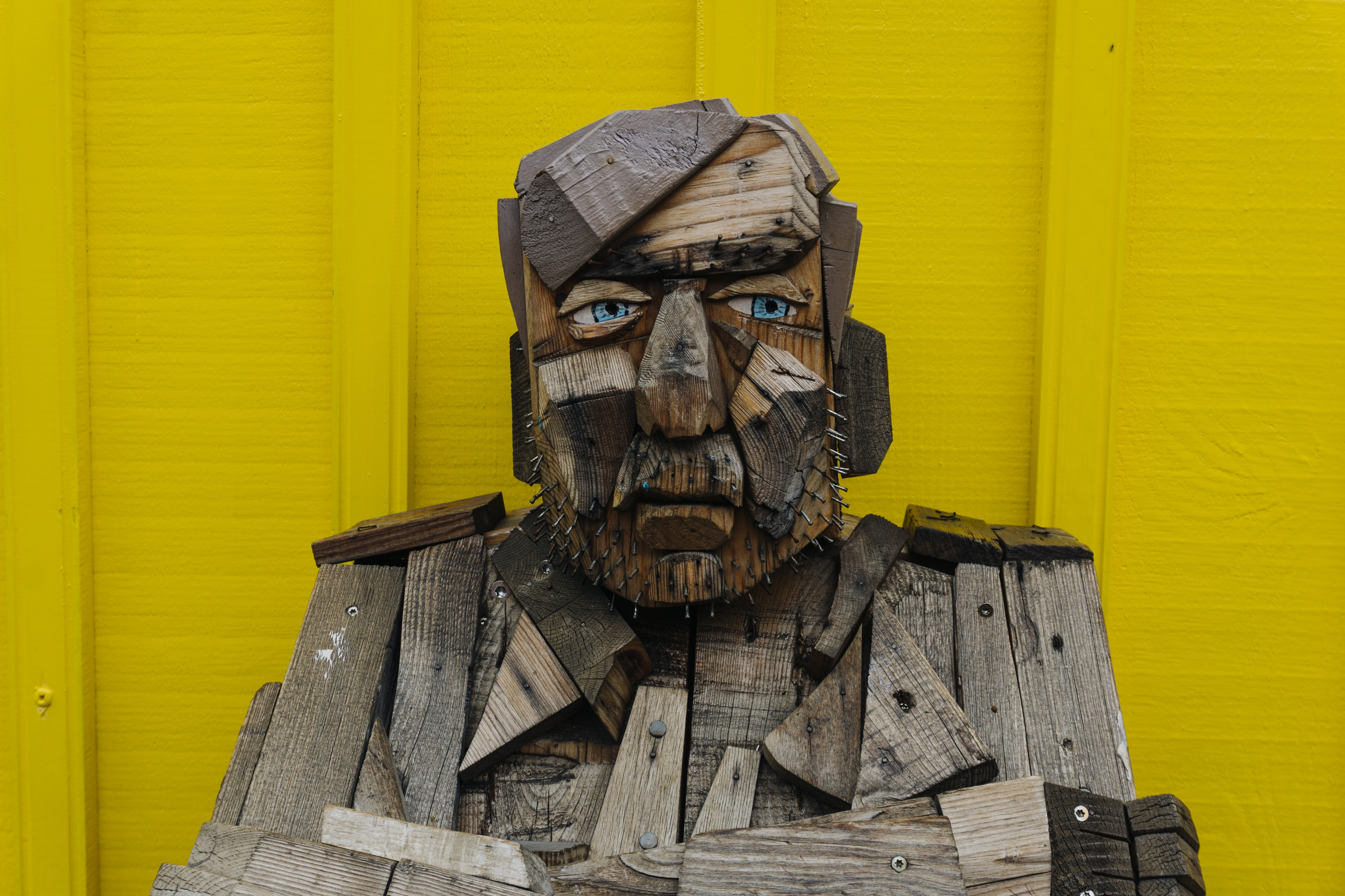gray and brown human face decor