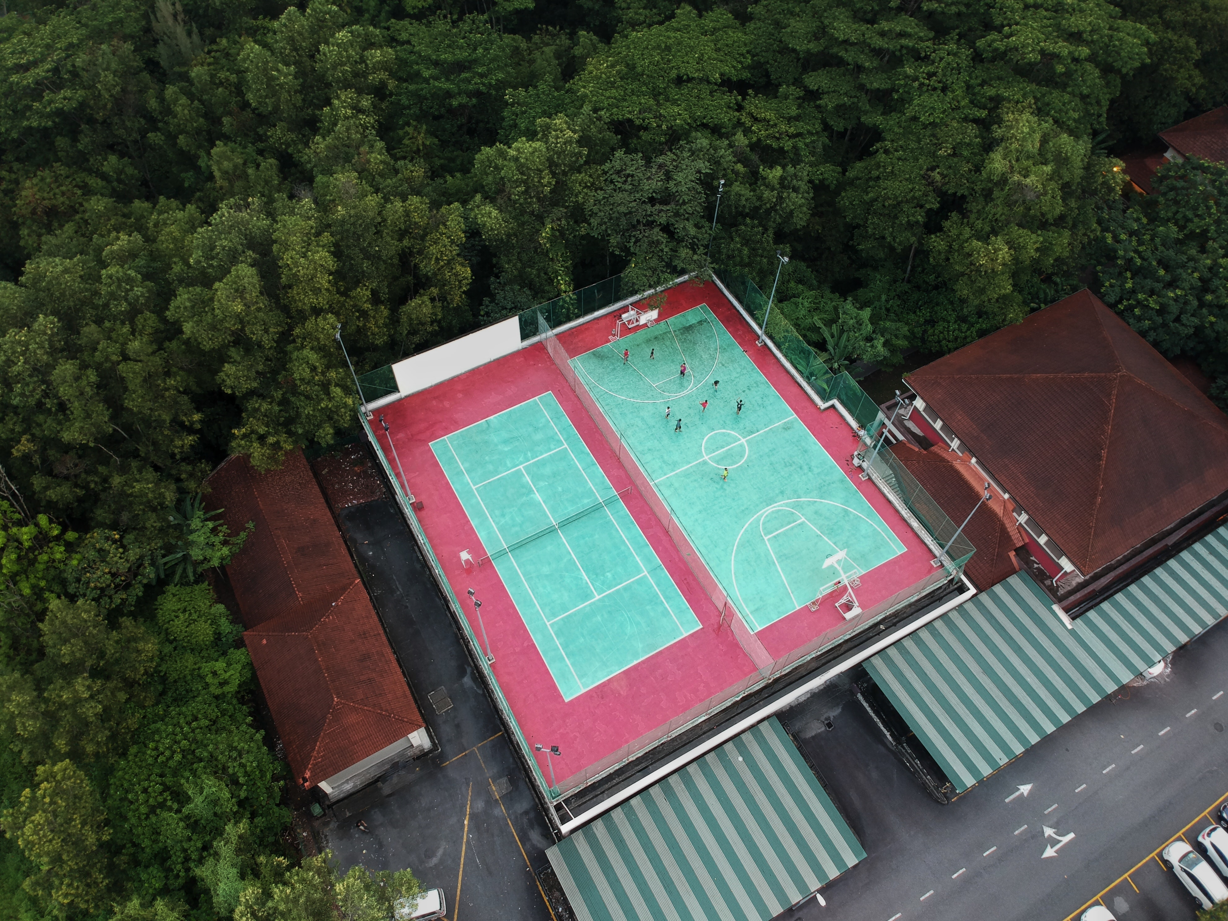 aerial photography of tennis and basketball courts