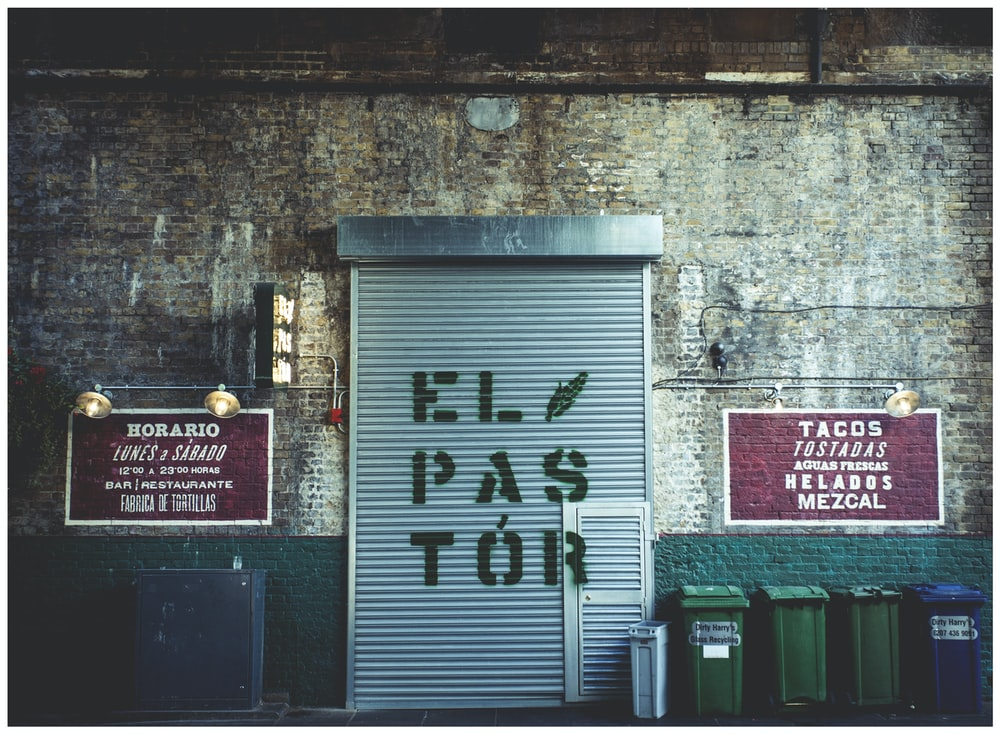 silver steel roller shutter with ElPASTOR signage
