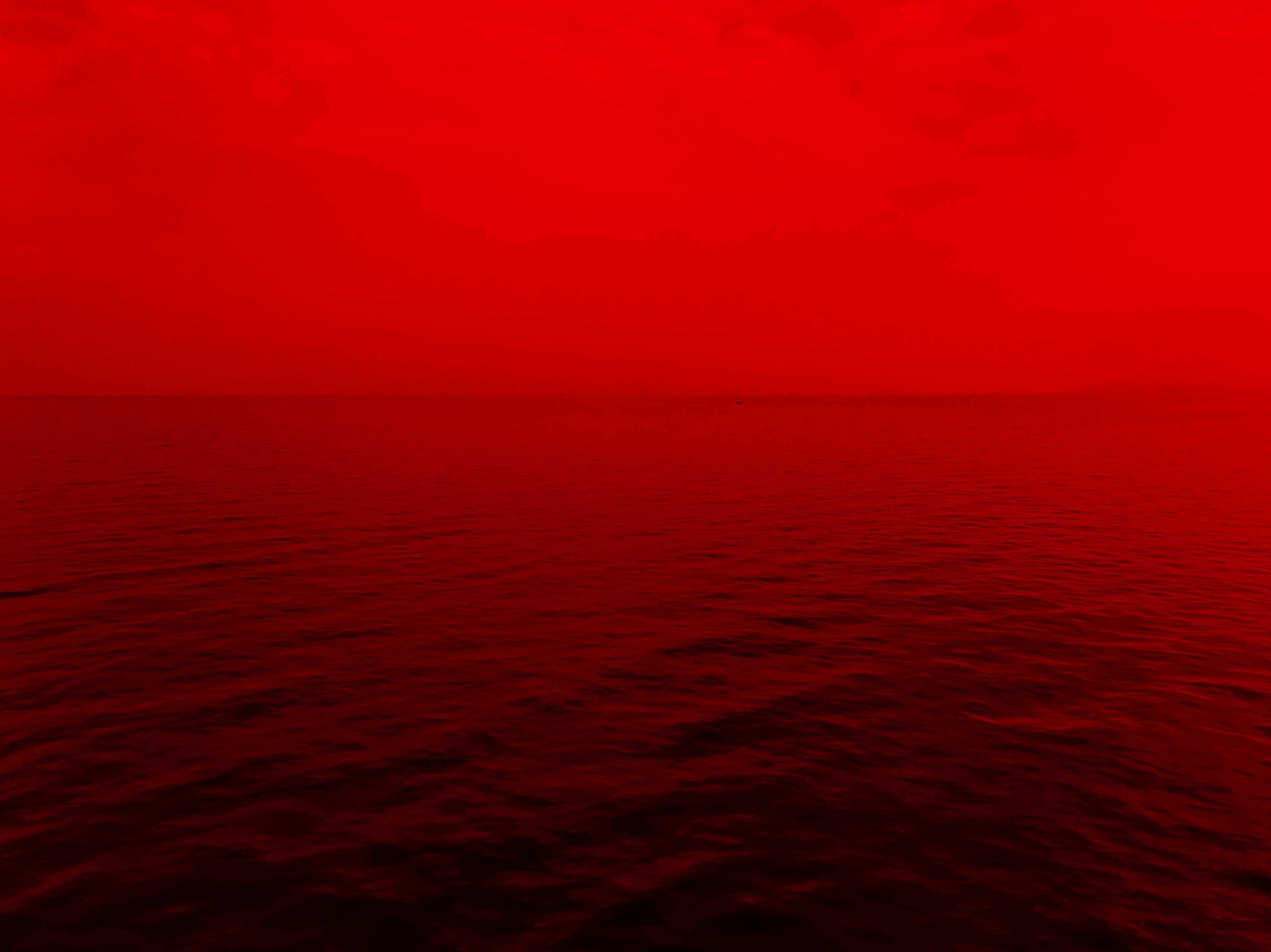 photo of ocean with red lights