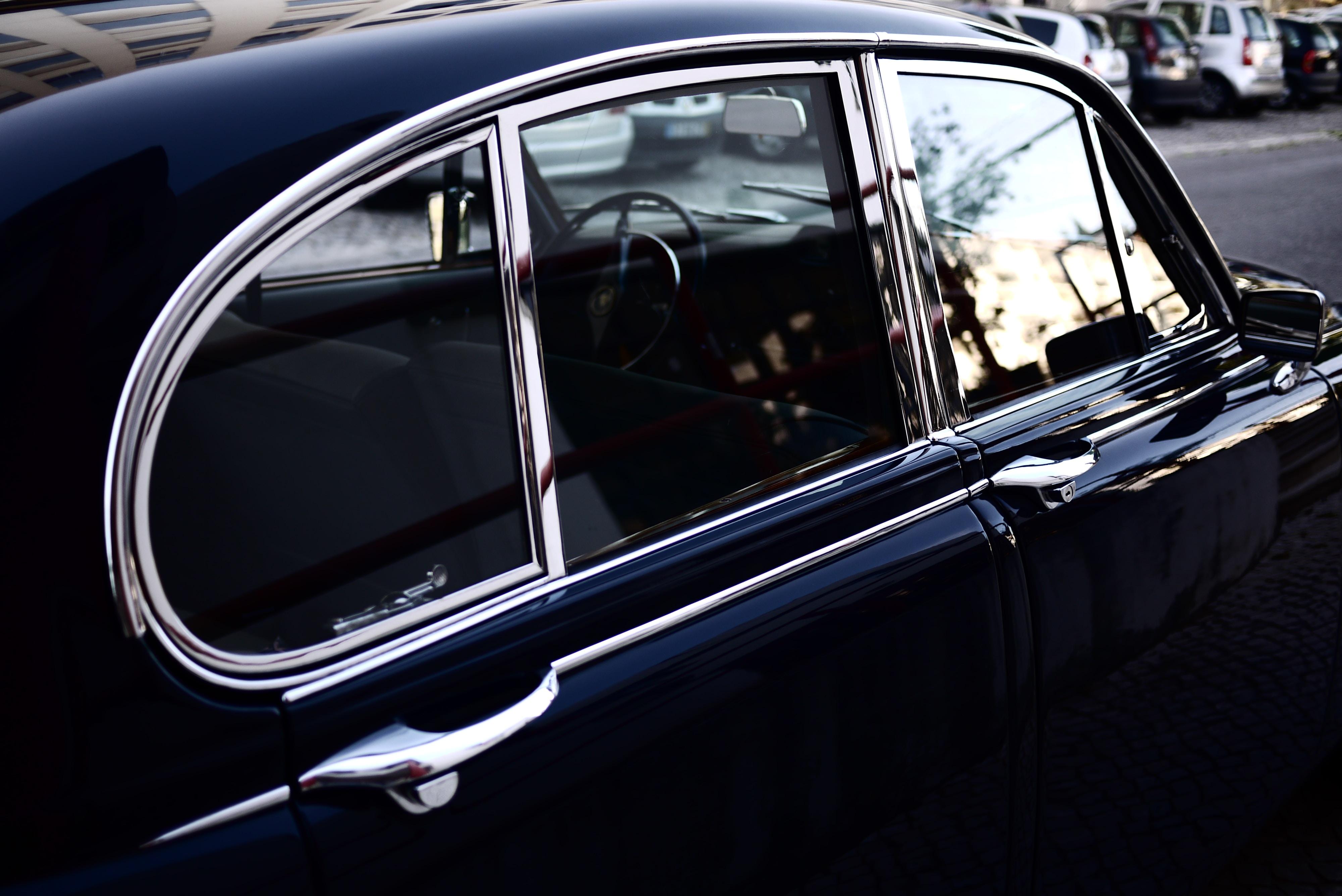 closeup photo of classic black car