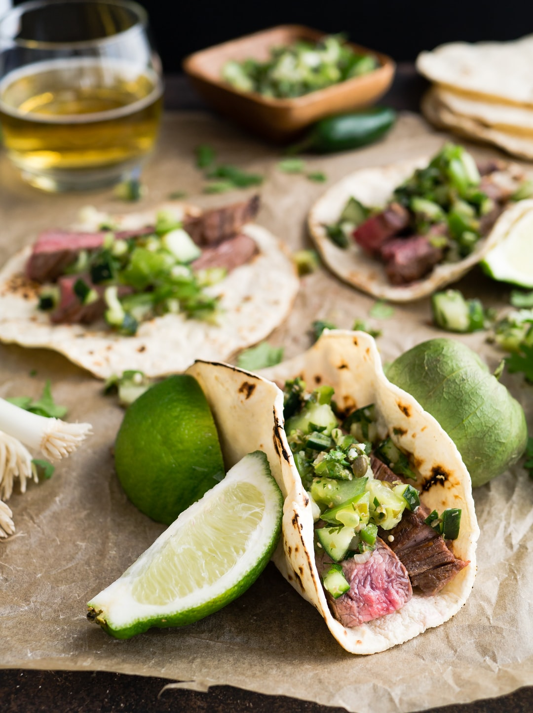 I love this recipe for margarita marinated flank steak tacos and I love the festive, loose atmosphere of this photo. It makes me feel like I'm at a friendly, slightly chaotic party celebrating with friends on a warm evening. Dancing is bound to follow the meal.