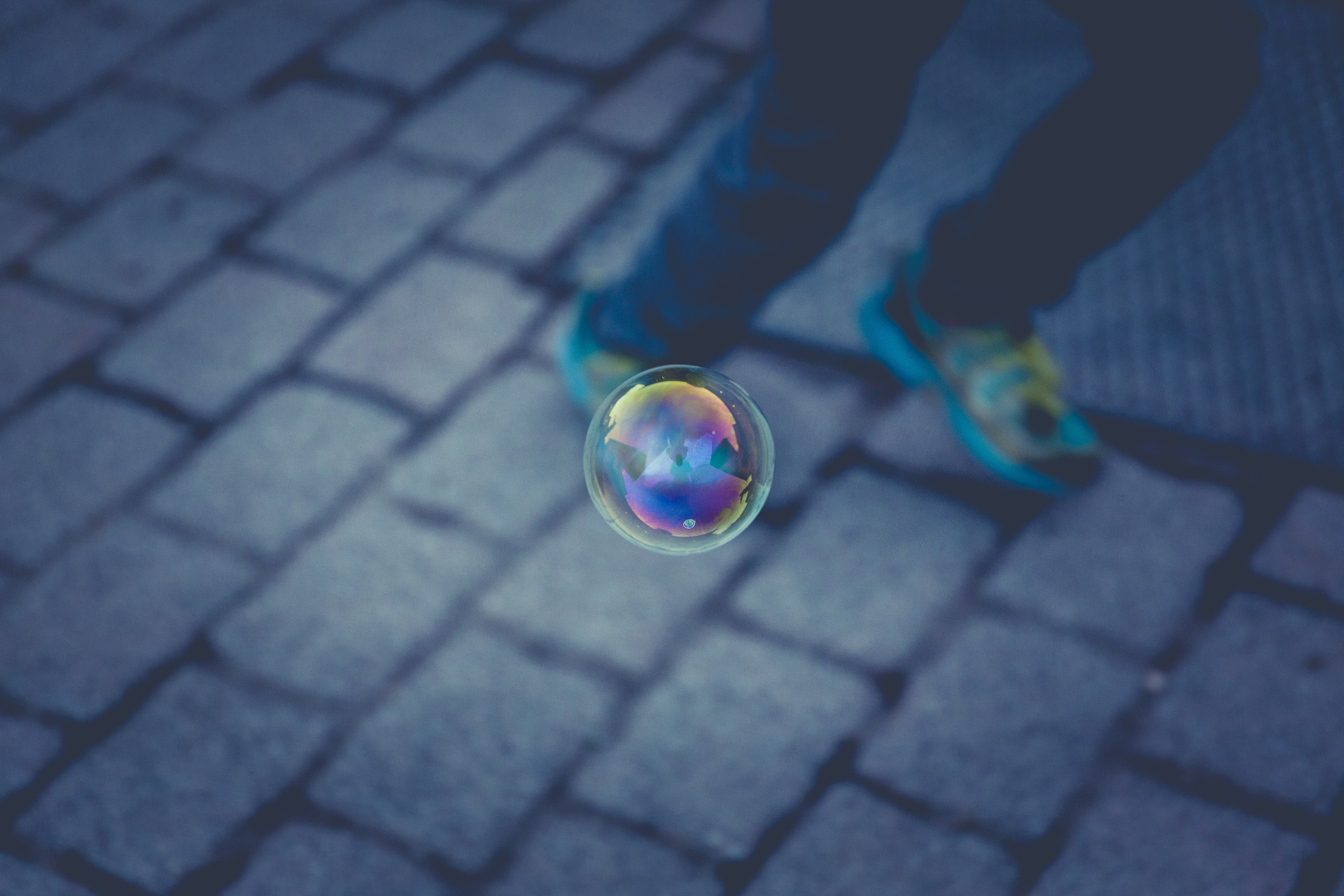 floating bubble near person running
