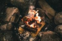 burn charcoal beside rocks