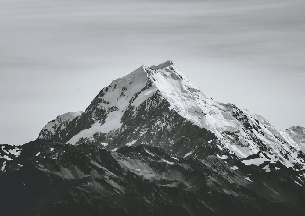 grayscale photography of snowcap mountain