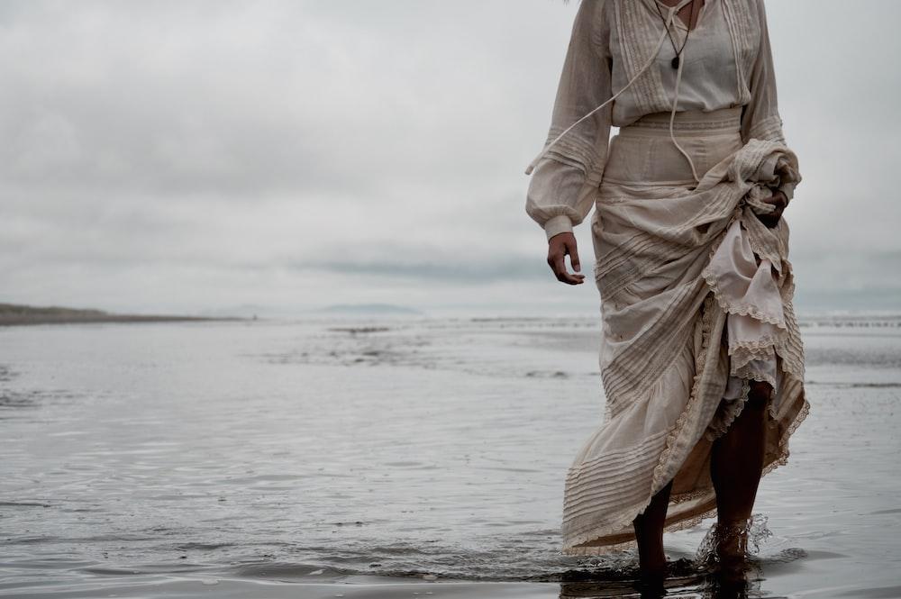 person standing on sea shore