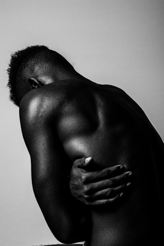 greyscale photo of naked man