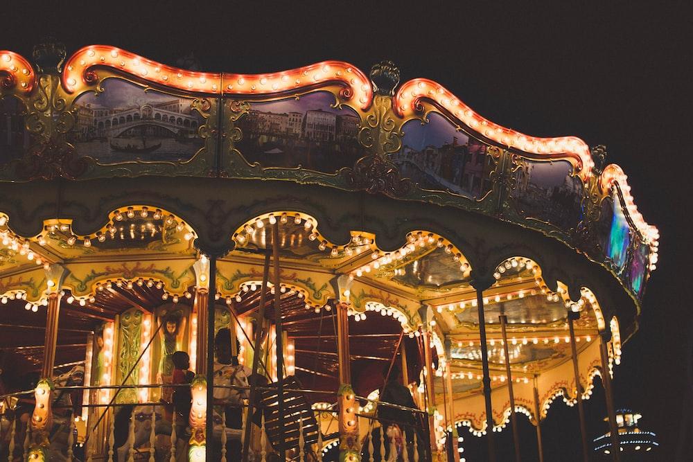 orange carousel ride during night time