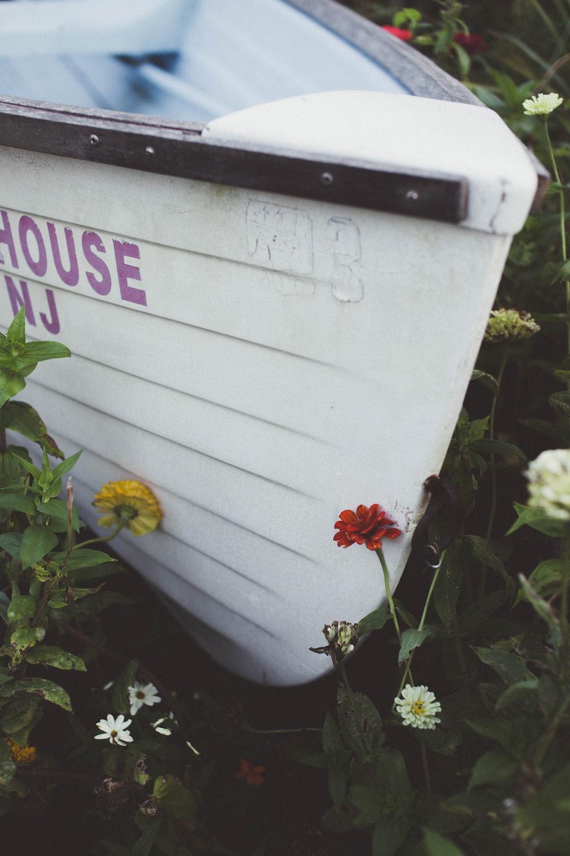 flowers around white boat
