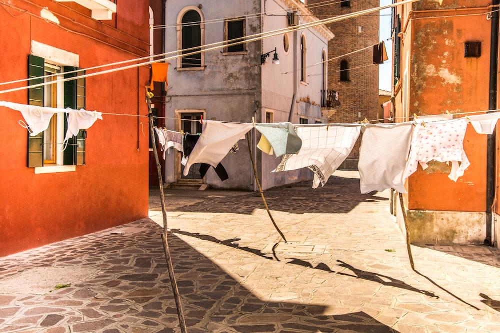 cloths hanging on rod