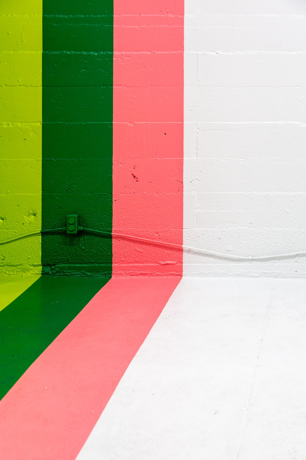 white, pink, green, and yellow painted wall