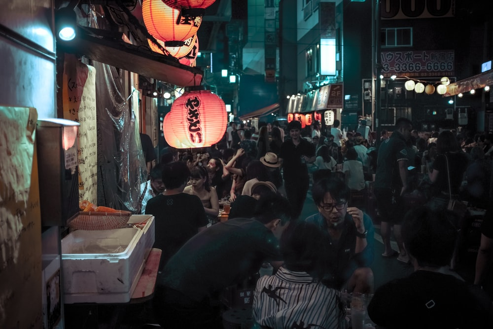 photo of people gathering in market during nighttime