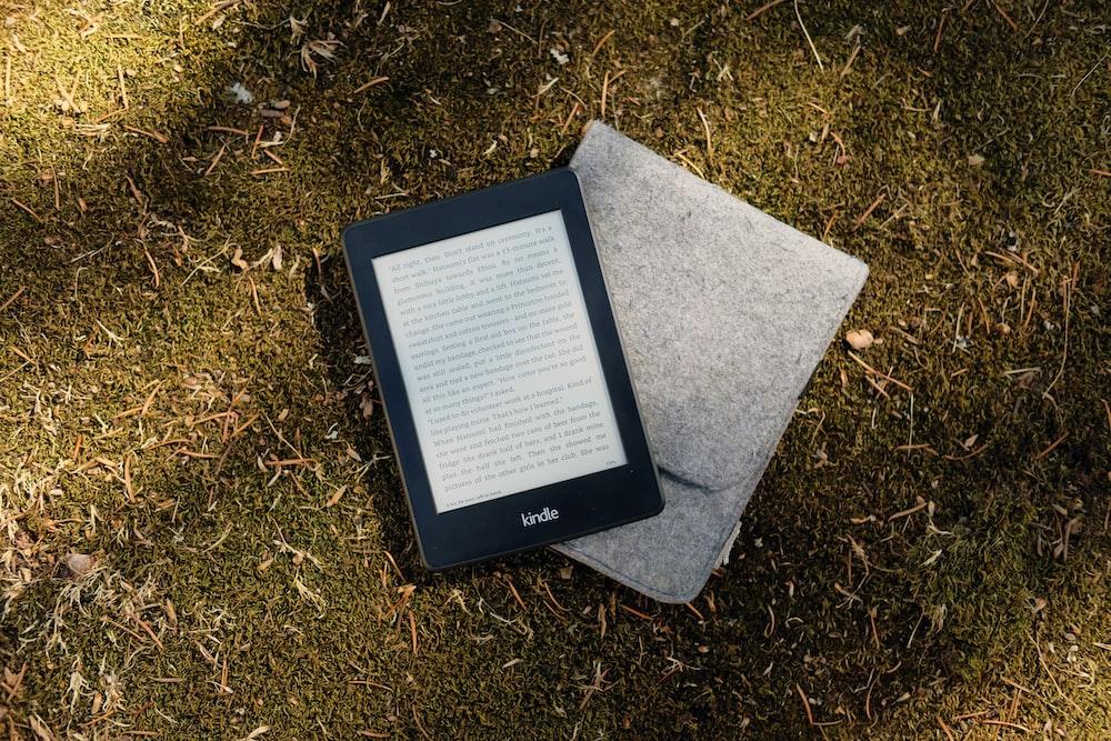 Kindle e-book reader on gray flip cover case