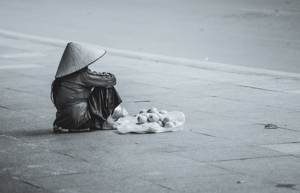 person sitting beside street