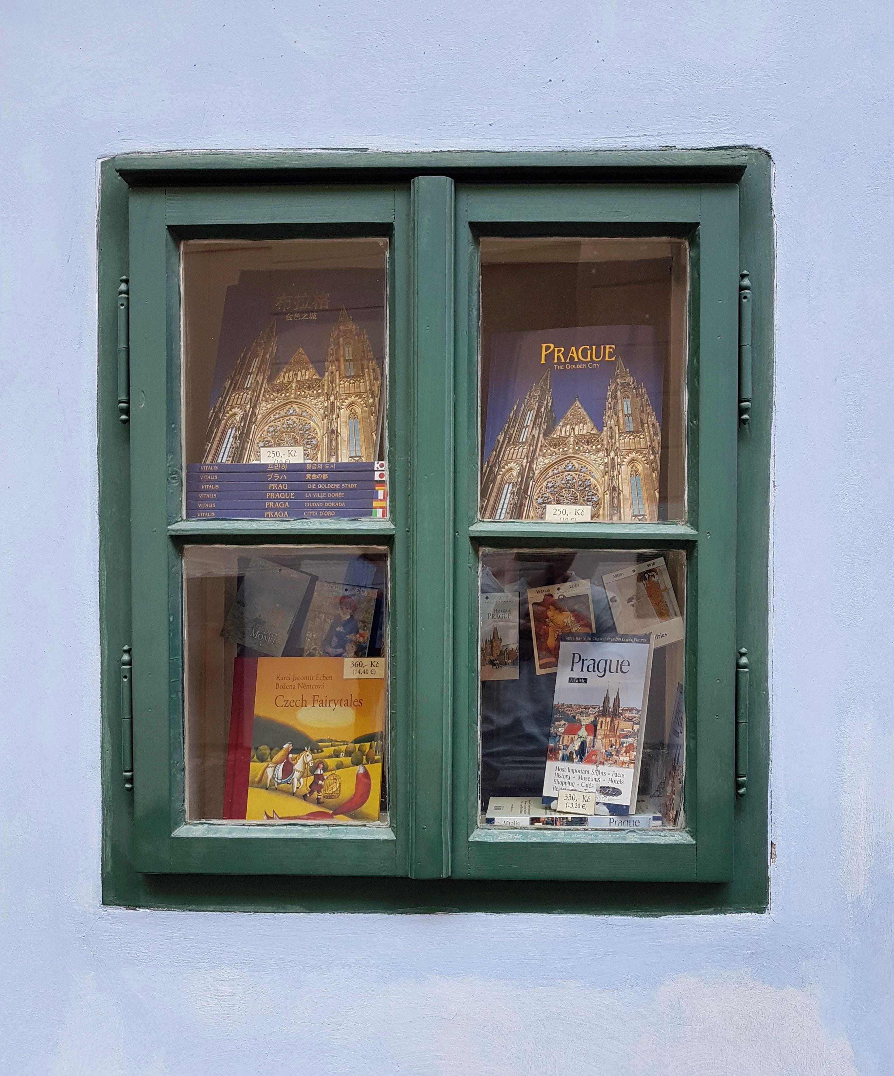 green wooden window panel