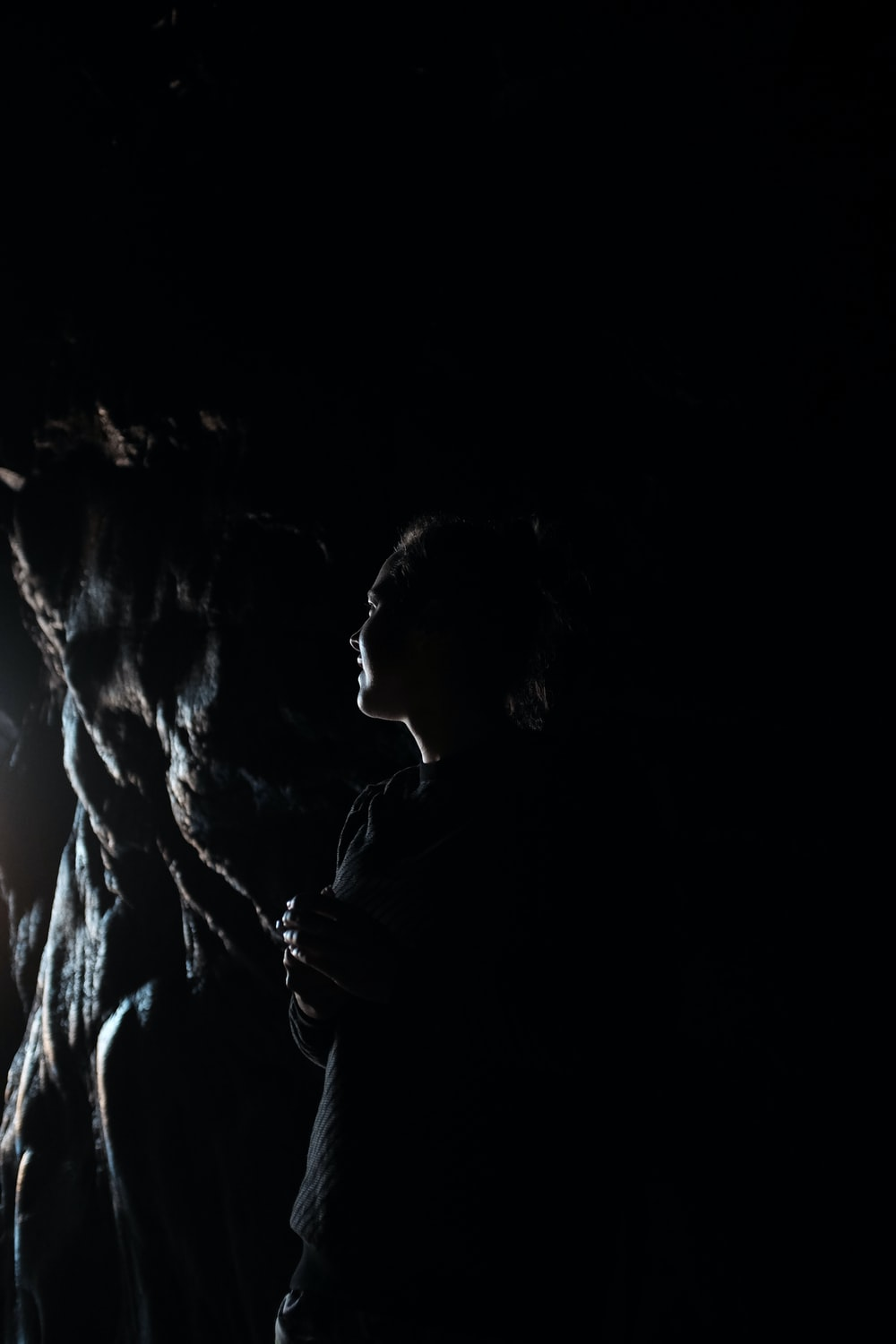 man and woman kissing in dark room