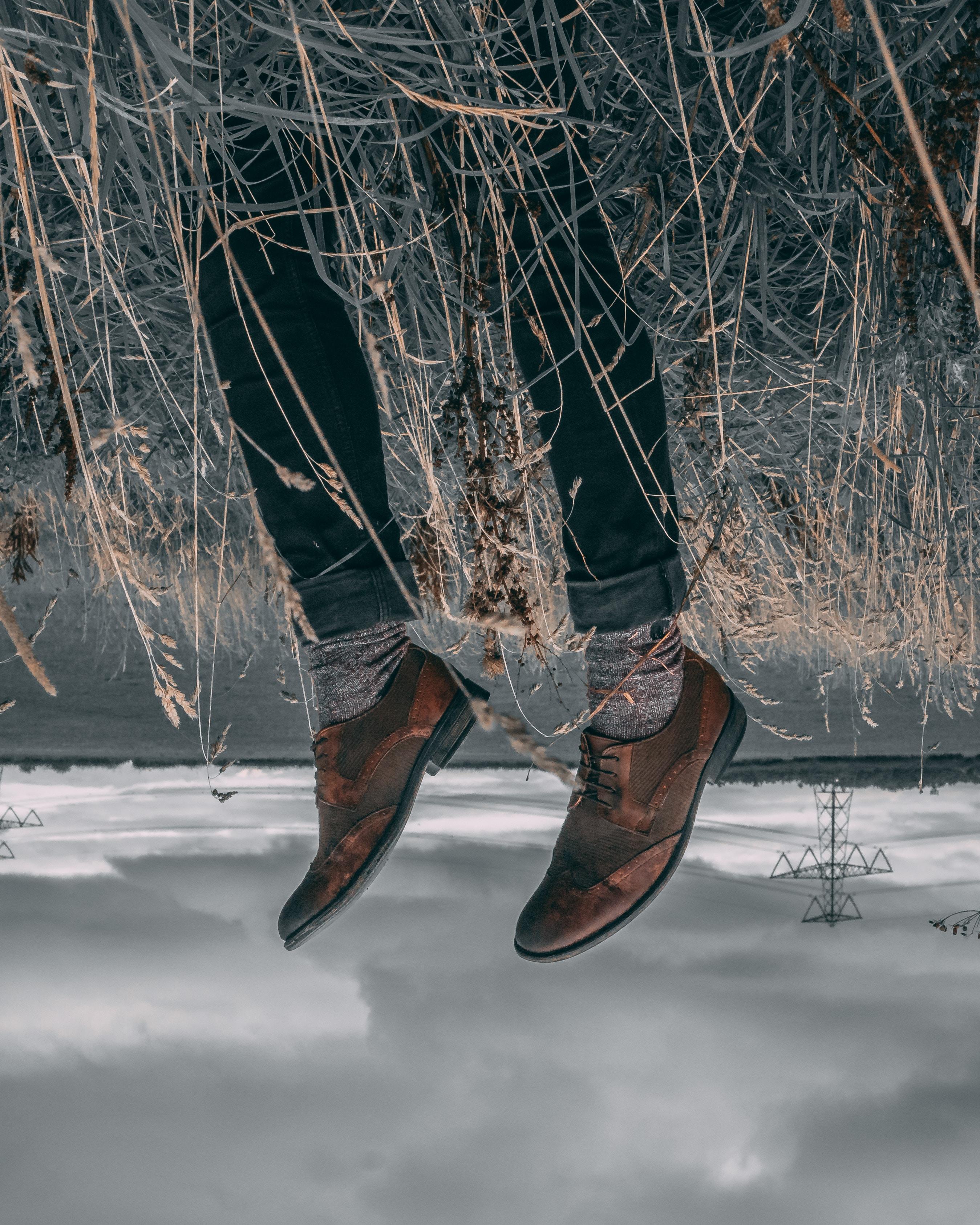 man wearing brown dress shoes
