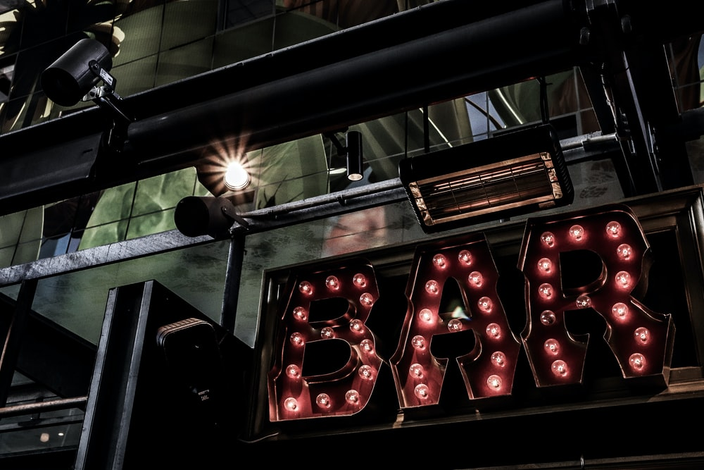 turned on red bar marquee lights