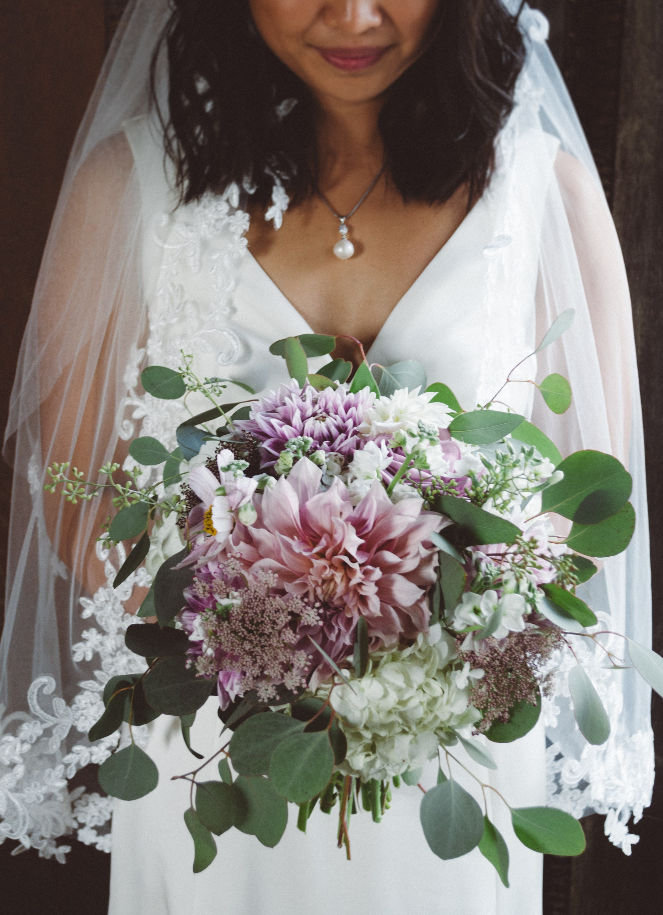 bride holding a bouquet of flower