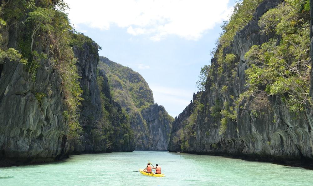 two men wearing life vest on boat