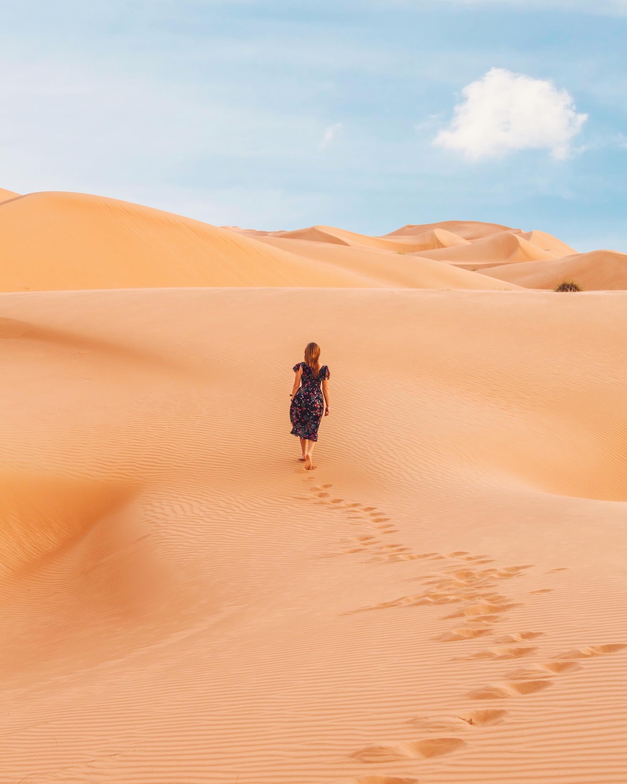 woman walking at desert