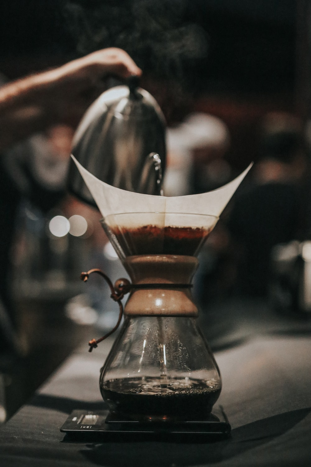 shallow focus photography of black and brown coffeemaker