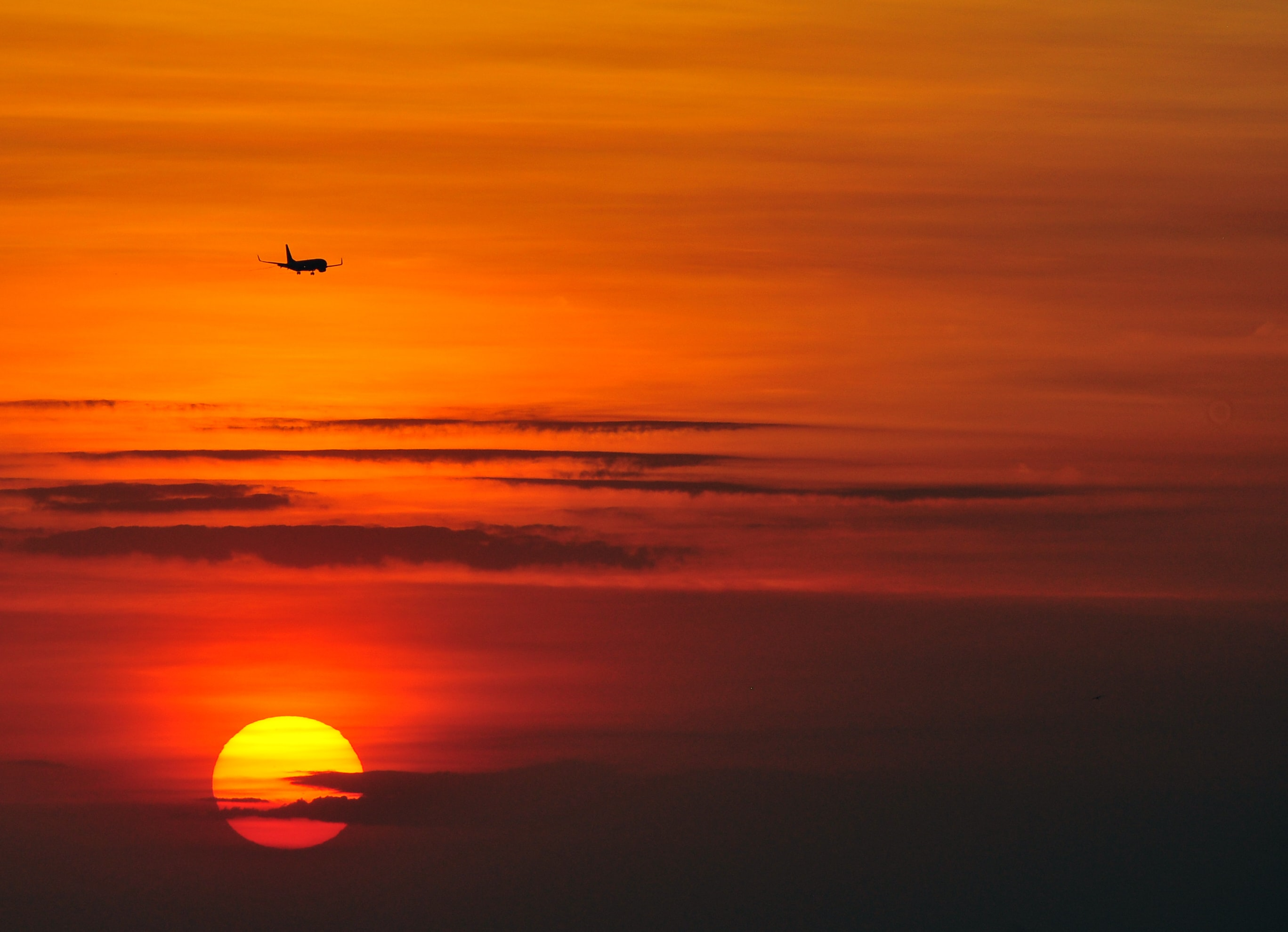 flying airplane during sunset
